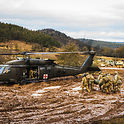 U.S. Army RANK NAME PERSON, of UNIT, does WHAT during EVENT, Jan. 31, 2020, at Hohenfels Training Area, Bayern. SECOND INFORMATIONAL SENTENCE HERE. (U.S. Army photo by Sgt. 1st Class Garrick W. Morgenweck)