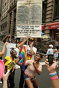 Christian evangelizers on the sidelines of the 2011 Pride Parade on New York's Fifth Avenue, while gay pride supporters pose for photos