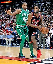 November 22, 2017 - Miami, FL, USA - The Miami Heat's Justise Winslow (20) looks to pass around the Boston Celtics' Al Horford (42) at the AmericanAirlines Arena in Miami on Wednesday, Nov. 22, 2017. The Heat won, 104-98. (Credit Image: © Al Diaz/TNS via ZUMA Wire)