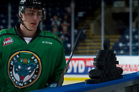 KELOWNA, CANADA - MARCH 18:  Kole Lind #16 of the Kelowna Rockets goes to clear the pucks from the boards to the ice for warm up against the Vancouver Giants on March 1, 2018 at Prospera Place in Kelowna, British Columbia, Canada.  (Photo by Marissa Baecker/Shoot the Breeze)  *** Local Caption ***