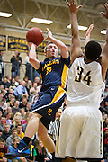 Prior Lake guard Jon Sobaski (11) is fouled mid-shot during the second half of the basketball game between Prior Lake and Apple Valley at Prior Lake High School, Friday, January 24, 2014.