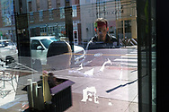 A customer picks up an order from a window at Terra Cafe on Mar. 21, 2020, in Easton, Pennsylvania. Communities across the Lehigh Valley are adjusting to life during the coronavirus pandemic that is impacting the daily lives of Pennsylvania residents both socially and economically. (Photo by Matt Smith)