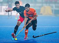 LUCKNOW (India) -   Junior World Cup hockey  U21 for men .  Malaysia v Egypt (2-0).  Ashran Hamsani (MAS) with  Mohamed Zakaria (EGY).  COPYRIGHT  KOEN SUYK