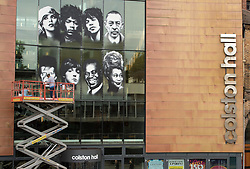 © Licensed to London News Pictures.  18/09/2017; Bristol, UK. Colston Hall, Bristol's largest music venue, is to unveil a new mural painted in partnership with Upfest by Bristol artist Voyder of eight musical legends, each of which have performed at Colston Hall over the last 150 years, to celebrate the Colston Hall's 150th anniversary this week on 20 September.   The giant mural on the glass panes above the main entrance will feature portraits of Ella Fitzgerald, Louis Armstrong, David Bowie, Debbie Harry (Blondie), Jimi Hendrix, Mick Jagger, Sergei Rachmaninoff and Paul McCartney. The mural will be in place in time for Colston Hall to mark its anniversary with a big free Birthday Bash on Wednesday 20 September, exactly 150 years from when the venue first opened, to which all of Bristol is invited. Highlights for the night will include the world-famous Ukulele Orchestra of Great Britain, immersive projections from Limbic Cinema and toe tapping swing music from the Bruce/Ilett Big Band. The free event will begin at 6.30pm and see a complete takeover of the building, giving people the chance to explore every corner, stumbling across musicians, DJs, installations and projections, as acts pop up to create a unique party atmosphere. Colston Hall first opened its doors to the public on the 20th September 1867, after The Colston Hall Company bought the land from Colston Boy's School in 1861 to fulfil their vision of building a concert hall in the city. The Hall has seen four iterations in its 60 years, with the fourth and present Colston Hall opening in 1951. Picture credit : Simon Chapman/LNP