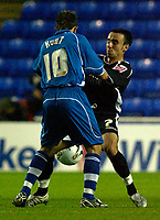 Photo: Daniel Hambury.<br /> Reading v Swansea. Carling Cup.<br /> 23/08/2005.<br /> Reading's Stephen Hunt and Swansea's Leon Britton battle for the ball.