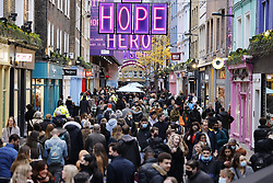 © Licensed to London News Pictures. 12/12/2020. London, UK. Christmas shoppers flock to Carnaby Street in London's West End. Experts are warning that London should be placed in tier three now to avoid a rise is coronavirus deaths over the Christmas period. Photo credit: Peter Macdiarmid/LNP