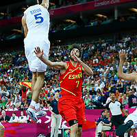 08 August 2012: France Nicolas Batum rejects Juan-Carlos Navarro layup during 66-59 Team Spain victory over Team France, during the men's basketball quarter-finals, at the 02 Arena, in London, Great Britain.