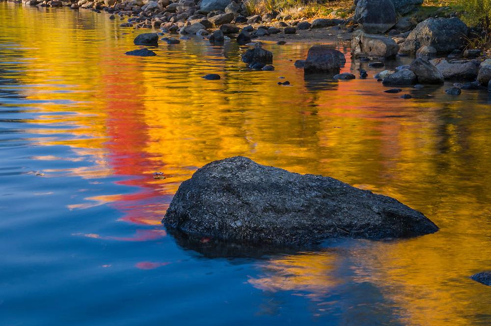 Rocks and reflections of fall colors, detail shot, Laconia, NH