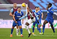 Football - 2020 / 2021 Premier League - West Ham United vs Brighton & Hove Albion - London Stadium<br /> <br /> West Ham United's Angelo Ogbonna clears under pressure from Brighton & Hove Albion's Neal Maupay.<br /> <br /> COLORSPORT/ASHLEY WESTERN