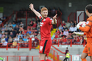 Matt Harrold tries to put off James Shea during the Sky Bet League 2 match between Crawley Town and AFC Wimbledon at the Checkatrade.com Stadium, Crawley, England on 15 August 2015. Photo by Michael Hulf.