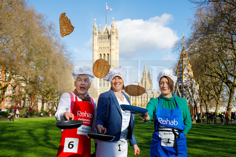 © Licensed to London News Pictures. 28/02/2017. London, UK. ALASTAIR STEWARD OBE, TRACEY CROUCH MP and BARONESS BERTIN practise their pancake flips before racing against MPs, Lords and members of media at of the annual Rehab Parliamentary Pancake Race outside the Parliament on Shrove Tuesday, 28 February 2017. Photo credit: Tolga Akmen/LNP