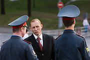 Moscow, Russia, 07/05/2006..A street photographer's impersonator of Russian President Vladimir Putin talks to two police officers on Manezh Square by the Kremlin.