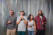 Co-owners Dietrich Wahlstrand, Grant Kjos, Michele Willaford, and Mike Willlaford, from left to right, pose for a portrait at Uproar Brewing Co. in San Jose, California, on September 2, 2015. (Stan Olszewski/SOSKIphoto)