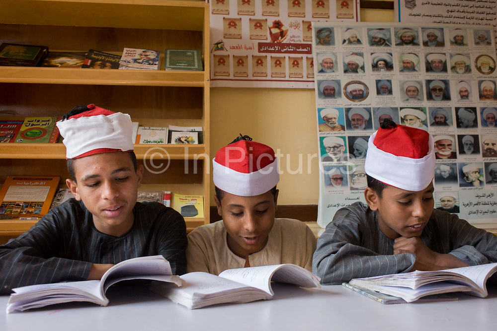Schoolboys learn verses from the Koran in a classroom at the Islamic Koom al-Bourit Institute for Boys in the village of Qum (Koom), on the West Bank of Luxor, Nile Valley, Egypt. Islam in Egypt is the dominant religion in a country with around 80 million Muslims, comprising 94.7% of the population, as of 2010. Almost the entirety of Egypt's Muslims are Sunnis, with a small minority of Shia and Ahmadi Muslims. The latter, however, are not recognised by Egypt.