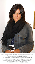 Shoe designer EMMA HOPE at an exhibition in London on 26th September 2002.PDN 206