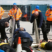 13 local activists locked themselves in specially made arm tubes to block the entrance to Quadrilla's drill site in New Preston Road, July 03 2017, Lancashire, United Kingdom. Councillor Mirand Cox is being cut loose by specialist team.The 13 activists included 3 councillors; Julie Brickles, Miranda Cox and Gina Dowding and Nick Danby, Martin Porter, Jeanette Porter,  Michelle Martin, Louise Robinson,<br /> Alana McCullough, Nick Sheldrick, Cath Robinson, Barbara Cookson, Dan Huxley-Blyth. The blockade is a repsonse to the emmidiate drilling for shale gas, fracking, by the fracking company Quadrilla. Lancashire voted against permitting fracking but was over ruled by the conservative central Government. All the activists have been active in the struggle against fracking for years but this is their first direct action of peacefull protesting. Fracking is a highly contested way of extracting gas, it is risky to extract and damaging to the environment and is banned in parts of Europe . Lancashire has in the past experienced earth quakes blamed on fracking.