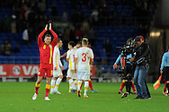 Craig Bellamy of Wales salutes the fans at the end of the match.  FIFA World cup 2014 qualifying match, Wales v Macedonia at the Cardiff city stadium in Cardiff on Friday 11th October 2013 pic by Andrew Orchard, Andrew Orchard sports photography,