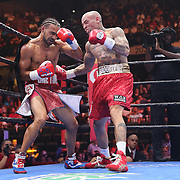 Keith Thurman (L) gets hurt from a body shot thrown by Luis Collazo during their Premier Boxing Champions boxing match for the WBA Welterweight title on ESPN at the USF Sun Dome, on Saturday, July 11, 2015 in Tampa, Florida.  Thurman won the bout when the corner of Collazo stopped the fight at the beginning of the eighth round. (AP Photo/Alex Menendez)