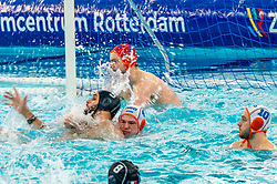 Guus Wolswinkel of the Netherlands in action against Enzo Khasz of France during the Olympic qualifying tournament. The Dutch water polo players are on the hunt for a starting ticket for the Olympic Games on February 17, 2021 in Rotterdam