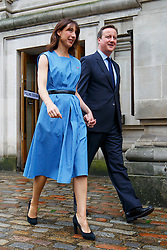 © Licensed to London News Pictures. 23/06/2016. London, UK. British prime minister DAVID CAMERON leave Methodist Central Hall in Westminster with his wife SAMANTHA CAMERON after casting his vote in the EU referendum. Photo credit: Tolga Akmen/LNP