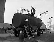 23/01/1959<br /> 01/23/1959<br /> 23/01/1959<br /> C.I.E. fuel tanks at Dublin Docks. Railtruck Fuel tank gets its logo repainted.
