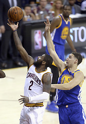 June 9, 2017 - Cleveland, OH, USA - The Cleveland Cavaliers' Kyrie Irving (2) drives past the Golden State Warriors' Klay Thompson in the first half during Game 4 of the NBA Finals at Quicken Loans Arena in Cleveland on Friday, June 9, 2017. (Credit Image: © Phil Masturzo/TNS via ZUMA Wire)