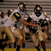 North Brunswick High School's Jabril Robinson hands the ball off to DeShawn Montgomery Friday September 13, 2013. (Jason A. Frizzelle)
