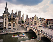 Ghent city centre with it's three-tower row, Sint Michael's bridge, the graslei and korenlei, Belgium, 26.06.2014