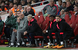 Arsenal manager Arsene Wenger (centre) during the Europa League match at the Emirates Stadium, London.