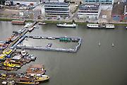 Nederland, Noord-Holland, Amsterdam, 16-04-2008; Danzigerkade met door Dedato architecten ontworpen kantoor waarin naast het architectenbureau zelf onder andere Hollandse Hoogte gehuisvest is; in het water van de Nieuwe Houthaven de bewaarhaven van binnenwaterbheer (voor boten en bootjes die weggeleept zijn);.de Danzigerkade bevindt zich rond de voormalige houthavens, en gebied wat momenteel ontwikkeld wordt..luchtfoto (toeslag); aerial photo (additional fee required); .foto Siebe Swart / photo Siebe Swart