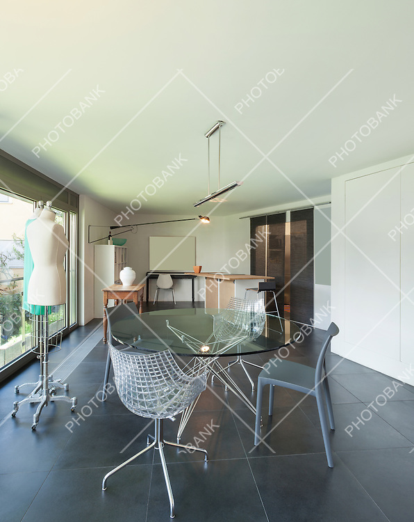 Interior of a studio apartment, wide room with glass table and dummies