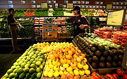 01 Feb 2006. Uptown, New Orleans, Louisiana.  Post Katrina. <br /> The Whole Foods supermarket reopens amidst great celebration 5 months after  the city was hit by Hurricane Katrina. Staff stock the store as customers come in.<br /> Photo; Charlie Varley/varleypix.com