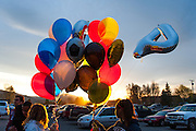 On May 2, 2014, students and friends of slain German exchange student, Diren Dede, carry balloons on to the soccer field at Fort Missoula where Dede played soccer. Dede wore jersey #4 when playing soccer.