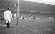 Galway goalie jumps in a failed attempt to save the ball as it goes over the bar for a point during the All Ireland Senior Gaelic Football Championship Final Dublin v Galway in Croke Park on the 22nd September 1963. Dublin 1-9 Galway 0-10.