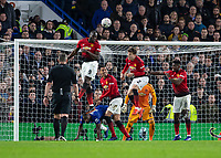 Football - 2018 / 2019 Emirates FA Cup - Fifth Round: Chelsea vs. Manchester United <br /> <br /> Romelu Lukaku (Manchester United) surrounded by his team mates and one chelsea player clears from a corner at Stamford Bridge<br /> <br /> COLORSPORT/DANIEL BEARHAM