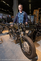 Sculptor and custom bike builder Don Cronin of Ireland with his MZ250 at the AMD World Championship of Custom Bike Building in the Intermot Customized hall during the Intermot International Motorcycle Fair. Cologne, Germany. Sunday October 7, 2018. Photography ©2018 Michael Lichter.