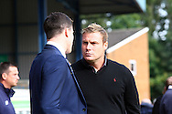 Bury Manager David Flitcroft (r) chats with Wigan Athletic Manager Gary Caldwell. Skybet football league one match , Bury v Wigan Athletic at the JD Stadium in Bury, Lancs on Saturday 10th October 2015.<br /> pic by Chris Stading, Andrew Orchard sports photography.