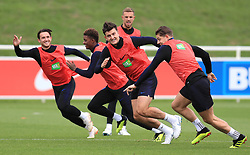 England's Harry Maguire (centre), James Tarkowski (right), Ben Chilwell, and Demarai Gray during the training session at St Georges' Park, Burton.