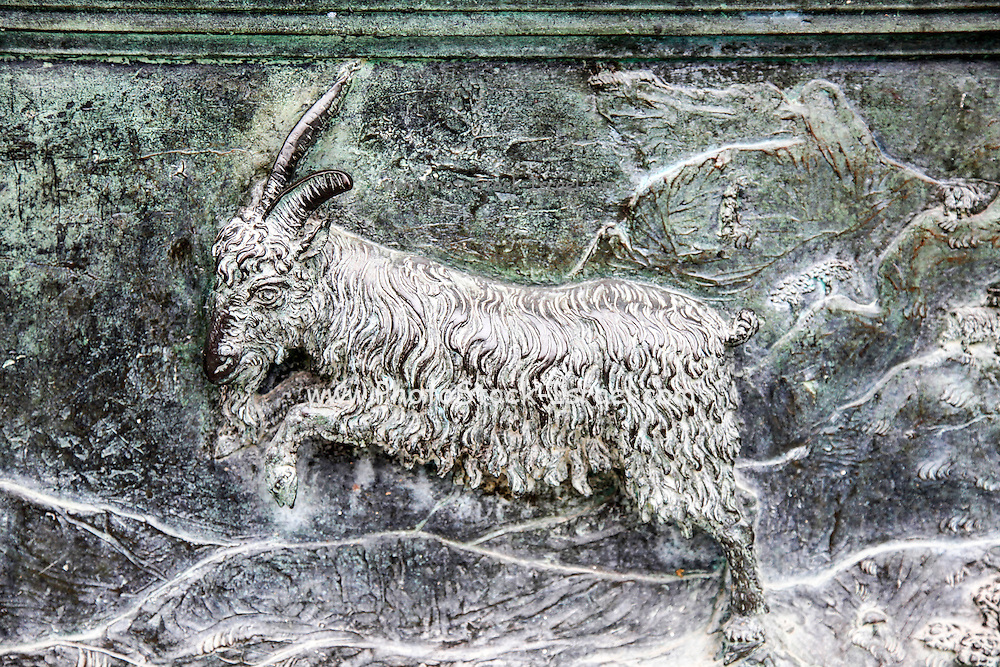 Roman period goat, carved relief on a sarcophagus panel inside the Camposanto Monumentale cemetery. Pisa, Tuscany, Italy.