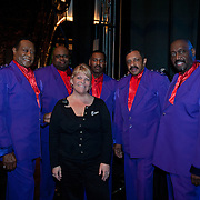 Temptations members Joe Hendon, Bruce Williamson, Terry Weeks, Ron Tyson, and Otis Williams (L to R) meet with a MH staff member backstage before their show at The Music Hall in Portsmouth, NH