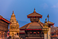 The statue of King Bhupatindra Malla (on the right),  Durbar Square, Bhaktapur, Kathmandu Valley, Nepal.