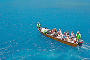 Tourists are ferried from the Yasawa Flyer ferry to a resort in the Yasawa Islands, Fiji.