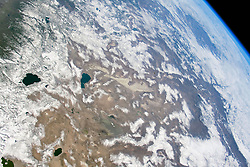 April 16, 2018 - California, U.S. - Astronauts aboard the International Space Station captured this photo while flying over the western United States. The wide field of view stretches from the Sierra Nevada of California to the Columbia Plateau of Oregon and the Snake River Valley of Idaho. A few days before the picture was taken, the Sierra Nevada around Lake Tahoe received a near-record amount of snowfall. During March 2018, Lake Tahoe was buried with 230 inches of snow after an unusually dry winter. Astronaut photograph ISS055-E-1038 was acquired on March 3, 2018, with a Nikon D5 digital camera using a 50 millimeter lens. (Credit Image: ? NASA/ZUMA Wire/ZUMAPRESS.com)