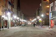 Middletown, NY - Pedestrians walk down North Street as snow falls during a winter storm on Dec. 19, 2008.