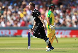 New Zealand's James Neesham (left) celebrates the wicket of Australia's Marcus Stoinis during the ICC Cricket World Cup group stage match at Lord's, London.