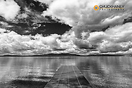 Dock reaches out into Skidoo Bay in Flathead Lake near Polson, Montana, USA