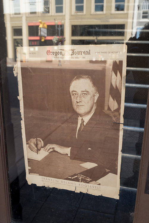 Old newspaper cover of FDR inauguration on a door in downtown Pendleton, Oregon.