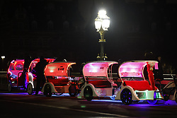 © Licensed to London News Pictures. 31/12/2020. London, UK. Rickshaws wait for customers on Westminster Bridge ahead of midnight and a muted New Year's Eve in central London. Photo credit: Peter Macdiarmid/LNP