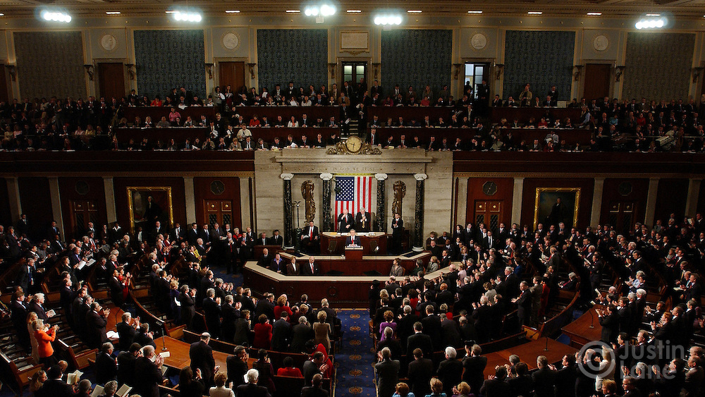 United States President George W. Bush, (center at podium) delivers his 2005 State of the Union Address to a joint session of Congress at the US Capitol in Washington DC 2 February 2005.
