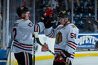 KELOWNA, BC - OCTOBER 20: Alex Overhardt #17 high fives Clay Hanus #58 of the Portland Winterhawks and celebrates the win against the Kelowna Rockets at Prospera Place on October 20, 2017 in Kelowna, Canada. (Photo by Marissa Baecker/Getty Images)
